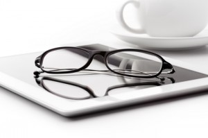 tablet-coffee-cup-glasses-white-table-image21698857